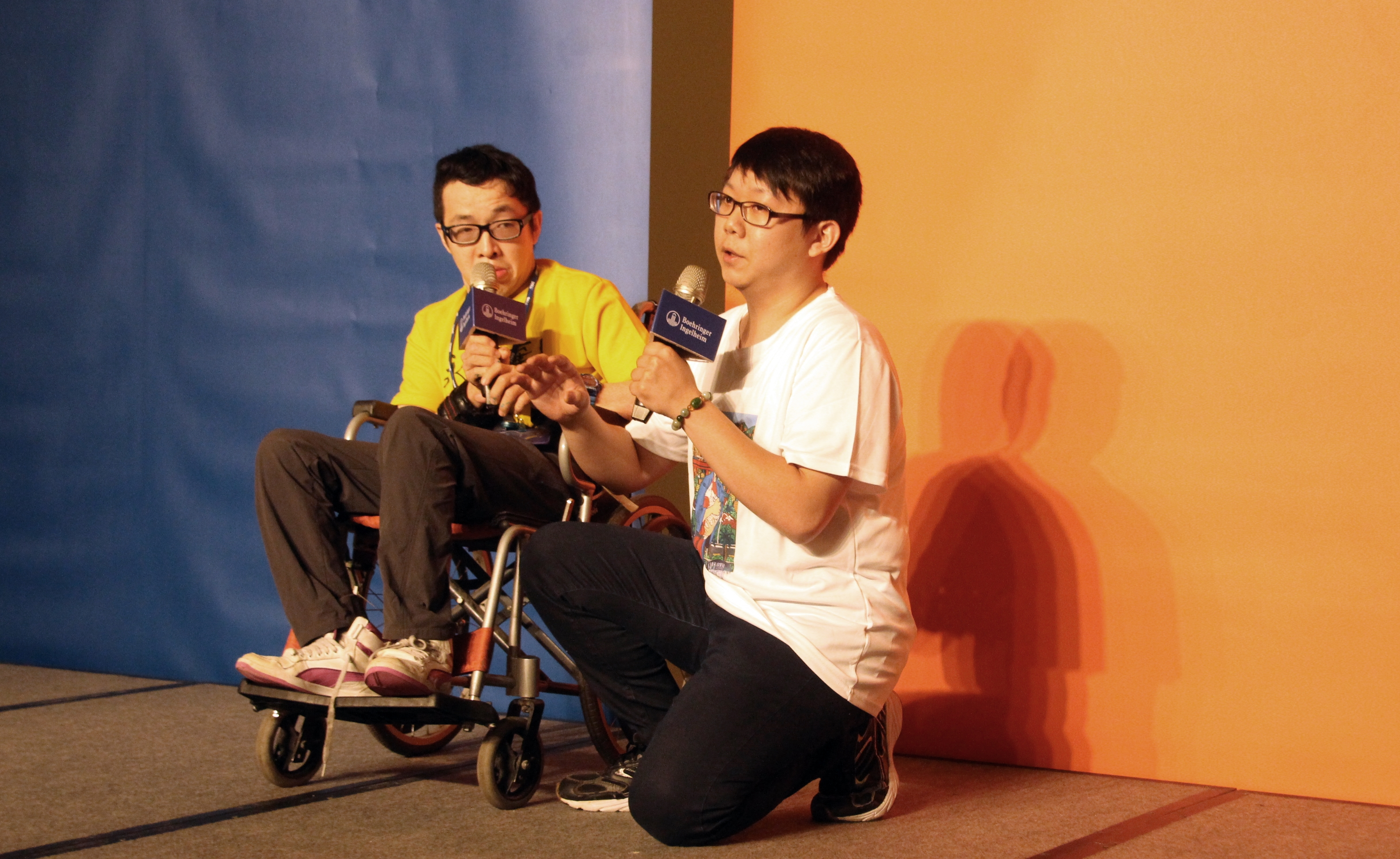 Disability Artist Duan-Zheng (left) happily sharing his thoughts on the event and his experience creating art